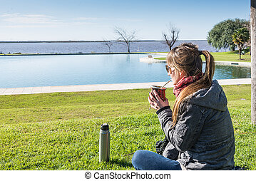 Argentine Young Woman, Relaxing and Drinking Mate. -...