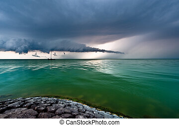 A storm cloud approaching on the IJsselmeer in The...