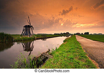 sunset windmill landscape - beautiful sunset windmill...