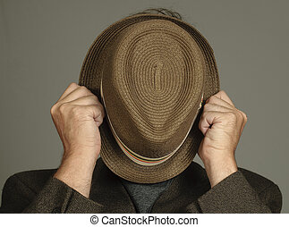 Embarrassed Man Hides His Face - Man with Hat in front of...
