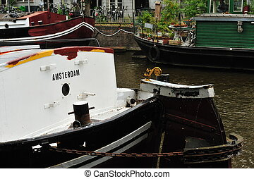 A boat with the word Amsterdam written on it