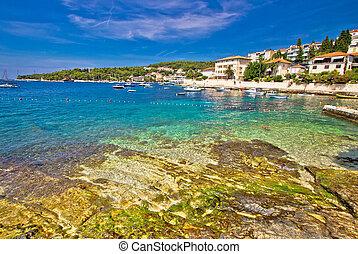 Turquoise stone beach on Hvar island, Dalmatia, Croatia
