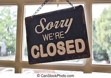 sorry were closed sign - window sign on chain sorry were...