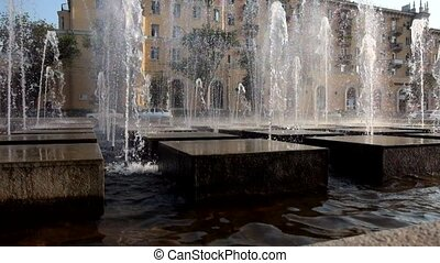 Modern city fountain made of granite cubes working