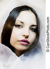 girl with dark blue eyes in a silk scarf