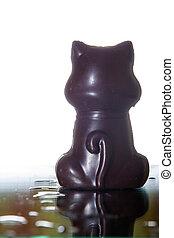 chocolate gift - dark chocolate cat figure isolated on white...