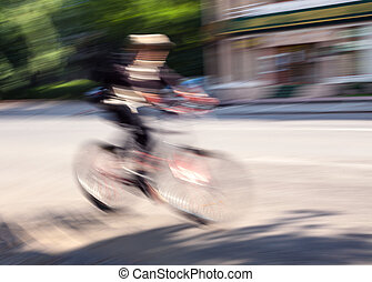 Boy cyclist in traffic on the city roadway - Speed. Boy...