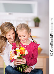 Girl Giving Flowers To Mother On Mother's Day - Little girl...