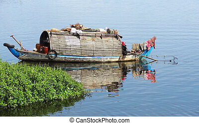 around Tonle Sap - waterside scenery with rural houseboat at...