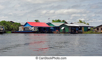 around Tonle Sap - waterside scenery with rural houses at...