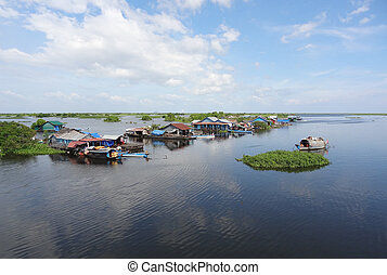 around Tonle Sap - waterside scenery with rural houses and...