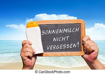 Text message - Sonnenmilch nicht vergessen on a slate -...