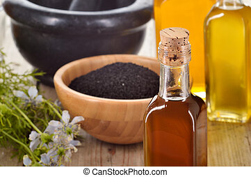 Close-up of nigella sativa oil - Close-up of nigella sativa...
