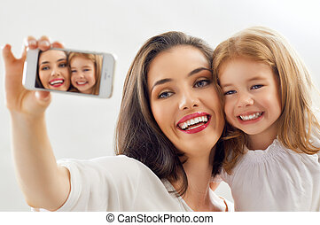 selfie - mother and daughter making a selfie