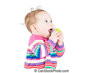 Cute curly baby girl playing with a ball, isolated on white