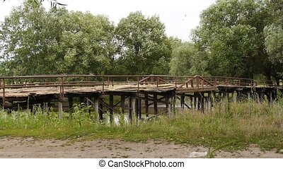 wooden bridge - Large wooden bridge over a river in the...