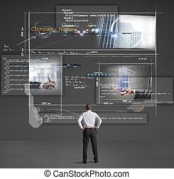 Building a website - Businessman shows a presentation of a...