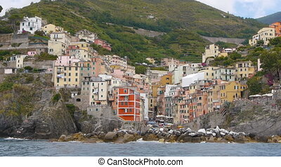 riomaggiore seen from boat italy - view of riomaggiore one...