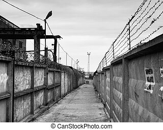 Barbed wire off road - Barbed wire on opposite fences on...