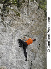 bouldering man on a rock wall in europe
