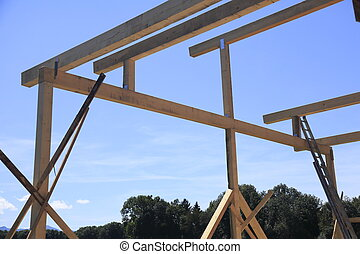 unfinished wood frame with blue sky background