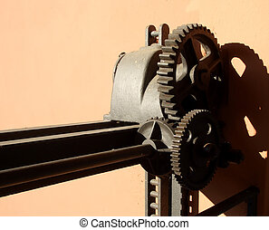 Watergate gears - Old rusted watergate gears against brown...