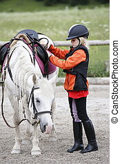 girl with horse - young girl with white little horse...