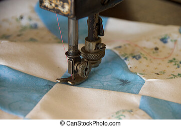 Patchwork Quilt - A patchwork quilt being sewn on an old...
