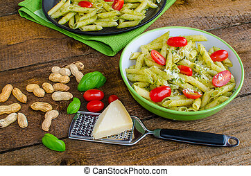 Fresh italien pasta with basil, tomato and parmesan cheese