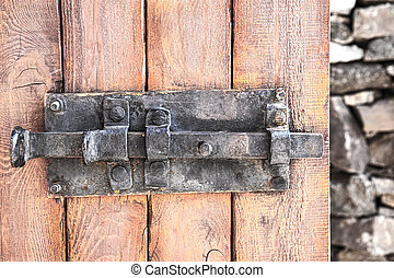 old metal bolt on wooden door