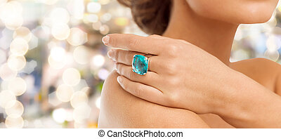 closeup of woman hand with big blue cocktail ring - wedding,...