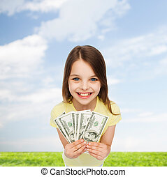 smiling little girl with dollar cash money - money, finances...