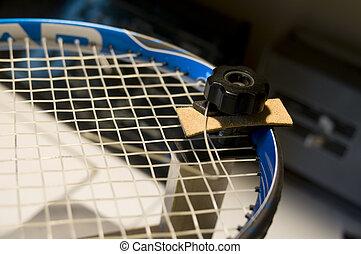 restring tennis racket - a tennis racket (racquet) being...