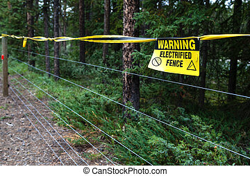 Electric Fence Warning - Selective focus on an electrified...