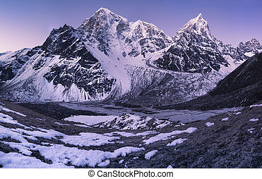 Sunrise in the Himalays Taboche and Cholatse summits -...