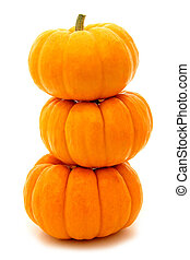 Tower of pumpkins - Group of pumpkins stacked over white