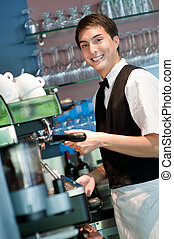 Barista Making Coffee - A young and attractive barista...