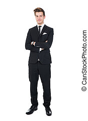 Portrait Of Confident Businessman - Full length portrait of...