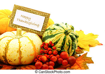 Happy Thanksgiving tag among a group of pumpkins, gourds and...