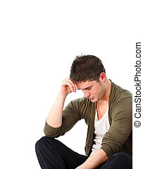 Depressed man sitting on the floor - Depressed young man...