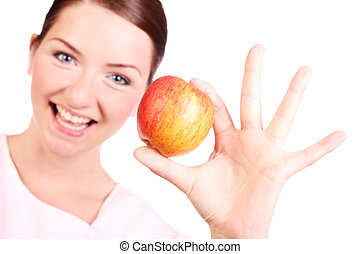 Happy woman with an apple - A happy young woman holding up...