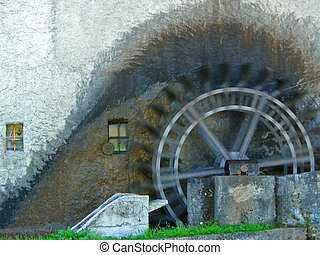 Antique watermill, wheel spinning - Antique watermill with...