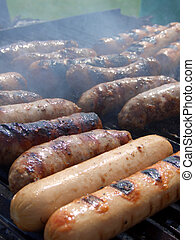 Sausages on grill, vertical - Sausages and wursts cooking on...
