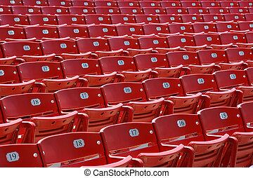 Red plastic seats, front