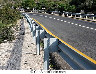 Road with guardrail closeup in perspective - Road in the...