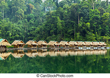 Bamboo huts on the lake Cheo Lan in Thailand.