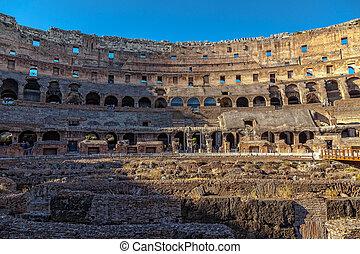 Interior Coliseum in Rome at sunset