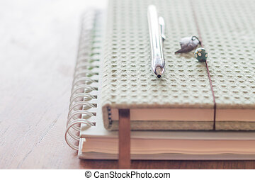 Pen on two notebooks, stock photo