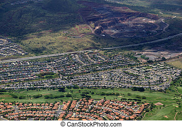 Aerial of Highway,  Kapolei homes, golf course, and quarry on Oa