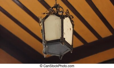 old lamp under the ceiling